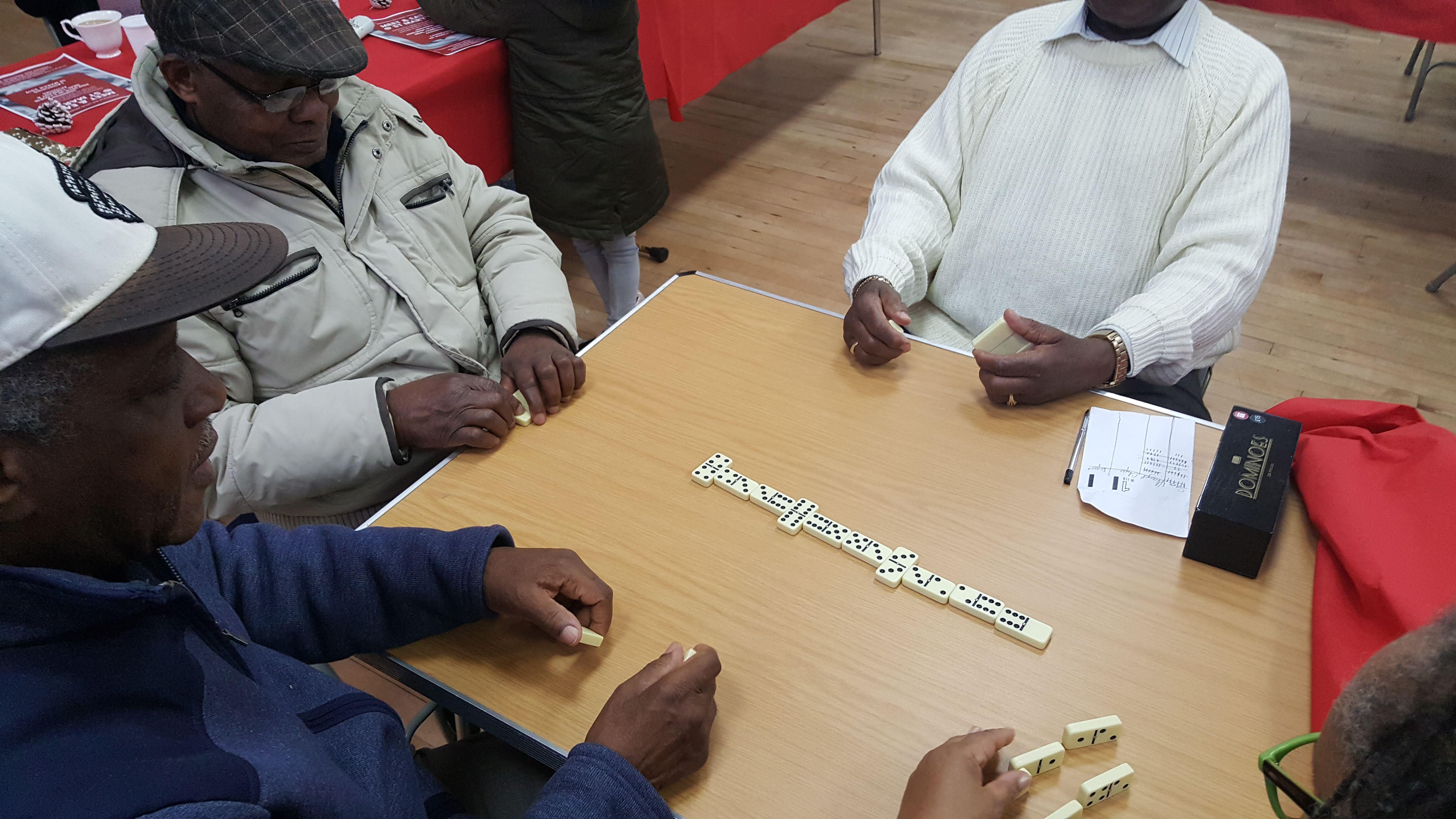 Xmas Event - 2018 - Elders enjoy a game of dominos